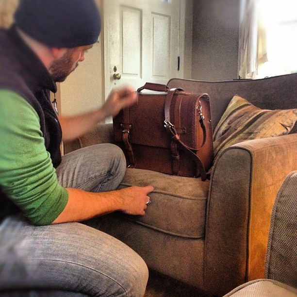 handmade leather bag being inspected by Seth Gray